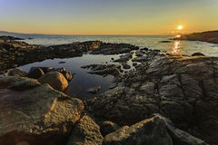 Baynes Beach. Sunrise over tide pools at Baynes Beach, at the end of Baynes Road on Ten Mile Point, in the Greater Victoria region of Vancouver Island, Saanich Royalty Free Stock Photos