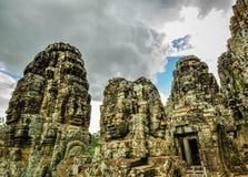 Bayon寺庙和吴哥窟高棉复合体在暹粒,柬埔寨 库存照片