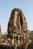 Bayon寺庙的石面孔在吴哥窟 库存图片