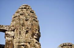 Bayon affronta dalle rovine di Angkor Wat, Cambogia Immagine Stock