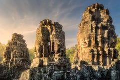 Bayon Angkor with stone faces Siem Reap, Cambodia. Sunrise view of ancient temple Bayon Angkor complex with stone faces of buddha Siem Reap, Cambodia royalty free stock photos