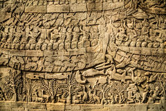 Bayon carved warriors. On the wall Stock Images