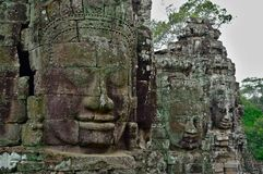 Stone faces of Bayon temple, Siemreap, Cambodia. Bayon constructed in the 12th and 13th century by Khmer king Jayavarman VII is a Buddhist temple in Angkor Thom royalty free stock image