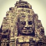 Bayon enfrenta, Angkor Siem Reap Camboja Foto de Stock
