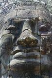 Bayon est remarquable pour les 216 sereins et les visages en pierre de sourire sur les nombreuses tours faisant saillie de la hau photographie stock libre de droits