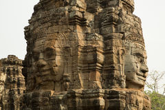Bayon face column. Bayon famous faces in a column Royalty Free Stock Image