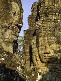 Bayon faces 2. Portrait view of two carvings of stone faces royalty free stock photos