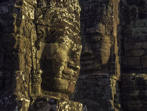 Bayon faces 2. Two giant stone faces carved out of stone blocks at ancient Khmer temple stock photos