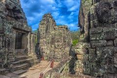 bayon kamienia twarze ludzie, siem przeprowadzają żniwa, Kambodża, byli inscri Fotografia Royalty Free