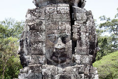 Bayon multiple faces large ancient carvings Royalty Free Stock Images