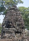Bayon is remarkable for the 216 serene and smiling stone faces on the many towers jutting out from the high terrace and cluster stock images