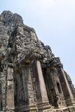 Bayon is remarkable for the 216 serene and smiling stone faces on the many towers jutting out from the high terrace and cluster royalty free stock image