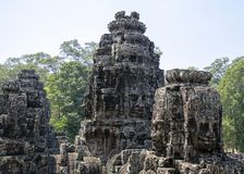 Bayon is remarkable for the 216 serene and smiling stone faces on the many towers jutting out from the high terrace and cluster stock photography