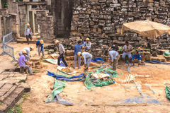Bayon, Siem Reap, Cambodia - December 7, 2016: Architects and wo. Angkor Thom, Bayon Temple, Siem Reap, Cambodia - December 7, 2016: Builders, bricklayer and Stock Images