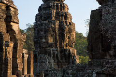 Bayon temple in angkor thom. Stone heads on towers of Bayon temple in Angkor Thom, Cambodia Royalty Free Stock Photography