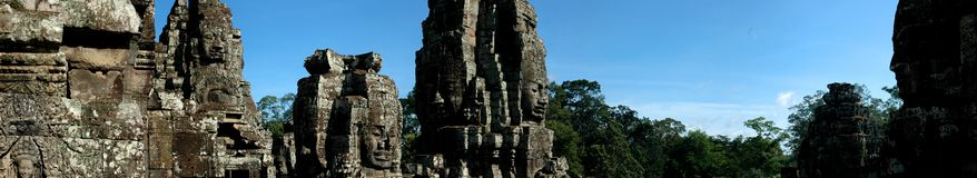 Bayon Temple Angkor Wat. Panorama of Stone Faces at the temple in Cambodia Stock Image