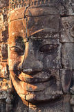 Bayon Temple in Angkor Wat, Cambodia. Close up view at sunset of one of the many large stone carved faces of Bayon Temple in Angkor Thom, Angkor district, Siem Stock Photography