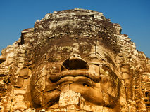 Bayon Temple in Angkor Wat, Cambodia. Dramatic view at sunset of one of the many large stone carved faces of Bayon Temple in Angkor Thom, Angkor district, Siem Stock Photos