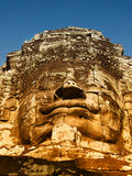 Bayon Temple in Angkor Wat, Cambodia. Dramatic view at sunset of one of the many large stone carved faces of Bayon Temple in Angkor Thom, Angkor district, Siem Royalty Free Stock Photos