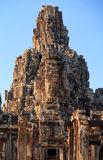 Bayon Temple in Angkor Wat, Cambodia. Dramatic view at sunset of one of the many large stone carved faces of Bayon Temple in Angkor Thom, Angkor district, Siem Stock Image