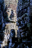 Bayon temple- Cambodia. Gigantic smiling face statues at the Bayon temple in the UNESCO World Heritage archaeological park of Angkor Wat ruins near Siem Reap Stock Photography
