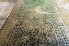 The Bayon temple is completely decorated. This patterned column has weathered and now moss picks out the finer details stock images