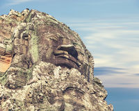 Bayon temple statue, Angkor, cross-process affect Royalty Free Stock Photo