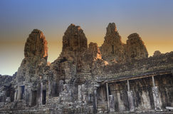 Bayon temple at sunset in Angkor Cambodia Royalty Free Stock Image