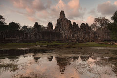 Bayon temple temple at  dusk with reflection Royalty Free Stock Photography