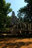 Bayon temple with trees. Bayon temple through the trees angkor cambodia Royalty Free Stock Images