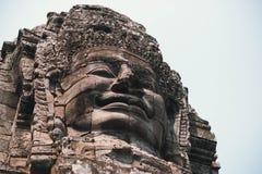 Bayonen är en välkänd och rikt dekorerad en khmertempel på Angkor i Cambodja arkivbild