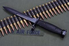 Bayonet and ammunition belt on US AIR FORCE uniform background. Bayonet and ammunition belt on US AIR FORCE uniform stock photos