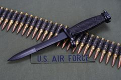 Bayonet and ammunition belt on US AIR FORCE uniform background. Bayonet and ammunition belt on US AIR FORCE uniform royalty free stock photo
