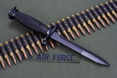 Bayonet and ammunition belt on US AIR FORCE uniform background. Bayonet and ammunition belt on US AIR FORCE uniform stock images