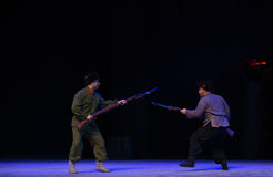 """Bayonet fighting-Peking Opera """"Taking Tiger Montain By Strategy"""". During the Chinese Cultural Revolution, some of which are set up as a model of stock photo"""