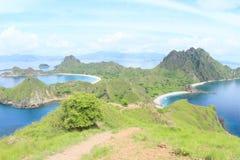 Bays on Padar Island. Famous bays on Padar Island with rocky mountain and grass hills - Komodo National Park, Nusa Tengara Timur - NTT, Indonesia Royalty Free Stock Photography