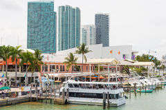 The Bayside Marketplace in downtown Miami. MIAMI,USA - MAY 27,2014 : The Bayside Marketplace in downtown Miami with a view of the yachts docked at the site and Royalty Free Stock Photos