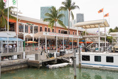 The Bayside Marketplace in downtown Miami. MIAMI,USA - MAY 27,2014 : The Bayside Marketplace in downtown Miami with a view of the yachts docked at the site and Royalty Free Stock Photography