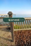Bayside sign near a pier over water Royalty Free Stock Image