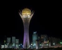 Bayterek at Night. Bayterek is a monument and observation tower in Astana, Kazakhstan. The shape of Bayterek represents a poplar tree holding a golden egg Stock Photo