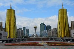 Bayterek Tower in Astana City Kazakhstan. The modern architecture of Kazakhstan capital city Astana, with golden buildings, skyscrapers and modernism futurism royalty free stock photography