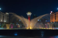 Bayterek Tower and  fountain show at night Stock Photo