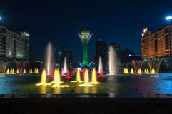 Bayterek Tower and  fountain show at night Royalty Free Stock Photography