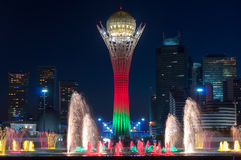 Bayterek Tower and  fountain show at night Royalty Free Stock Images