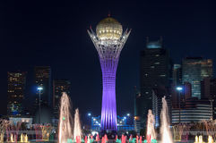 Bayterek Tower and  fountain show at night Stock Photos