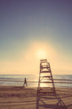 Baywatch chair in beach at summer sunset Stock Photo
