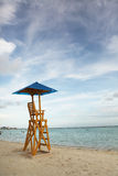 Baywatch chair in a beautiful beach empty at summer sunset. Royalty Free Stock Photography