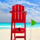 Baywatch red seat green wind flag Stock Images