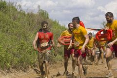 Baywatch team at the mud run competition Stock Photo