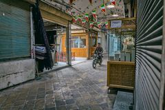 Bazaar biker in Yazd Stock Photos
